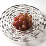 Circular Dish Form Six concentric, free flowing circular rings surrounding a concave centre.  The dish further develops a fascination with the effect of light, shade and movement as perceived on the surface of free flowing water.  Diameter 220mm