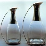 From half bottle size to two litre decanters designed and made to suit the glass which I have blown for me. The ones shown are lined both inside and outside.