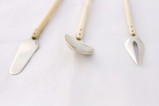Breakfast Cutlery Sterling silver cutlery hand formed into shaped and attached to locally sourced holly wood handles. Riveted together with tubes for unusual detailing. The set consists of a teaspoon, fork and butter knife. Priced between £100 - £130 per piece, as a set £325.